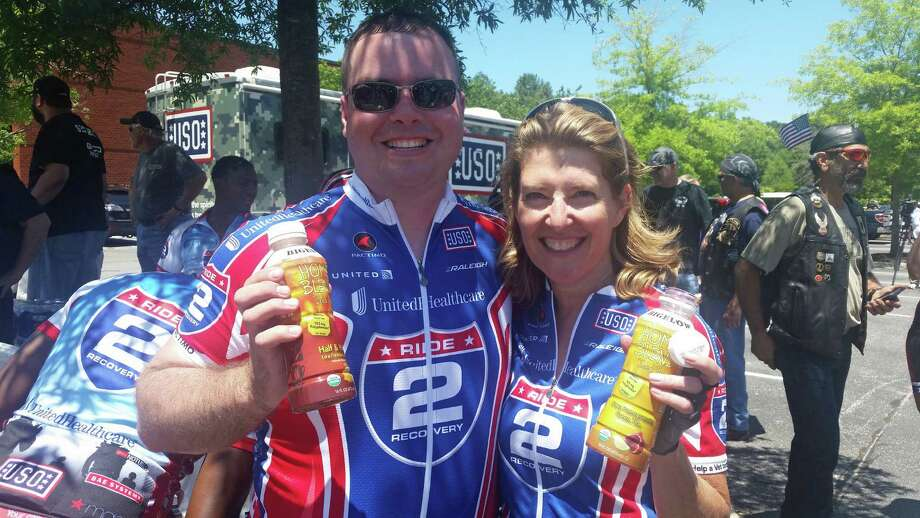 Bigelow Project Manager Tim Richmond, a U.S. veteran, and Bigelow Tea President and CEO Cindi Bigelow at Ride 2 Recovery Memorial Challenge USO's 2015 Warrior Week in Virginia Beach, Va., last month. Photo: Contributed Photo /