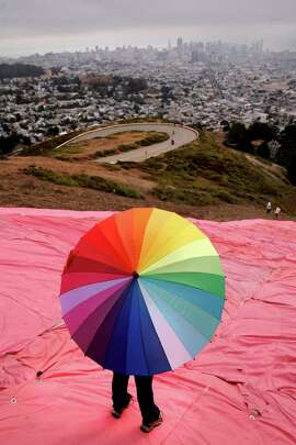 Volunteers atop Twin Peaks in San Francisco on Saturday install the pink triangle for Pride festivities fired up by the historic ruling. Story on A17