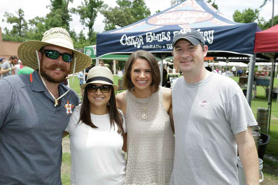 People pose for Seensters during The Woodlands Craft Beer and Music Festival  at Town Green Park, 2099 Lake Robbins Drive, Saturday, June 27, 2015.  Participating breweries included Abita, 8th Wonder Brewery, Omission, Saint Arnold, Karbach, Cycler's Brewing, Kona Brewing Co., Sierra Nevada, Rogue and Southern Star. Photo: Melissa Phillip, Houston Chronicle / © 2015  Houston Chronicle