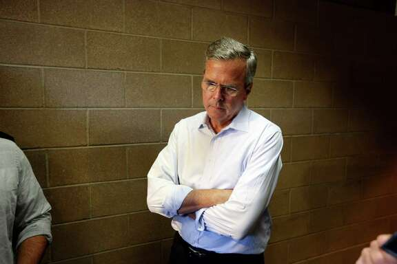 Republican presidential candidate, former Florida Gov. Jeb Bush waits in a hallway after a campaign event Saturday, June 27, 2015, in Henderson, Nev. (AP Photo/John Locher)