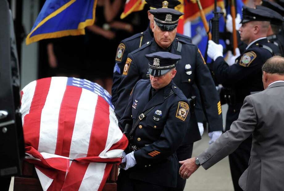 Funeral services take place for Milford Police Officer Michael Compare Saturday, June 27, 2015, at Saint Ann's Church in Milford. Compare, a 36-year-old, 1996 Jonathan Law High School graduate and three-year veteran of the Milford Police Department, was buried at Saint Mary's Cemetery in Milford. Photo: Autumn Driscoll / Hearst Connecticut Media / Connecticut Post