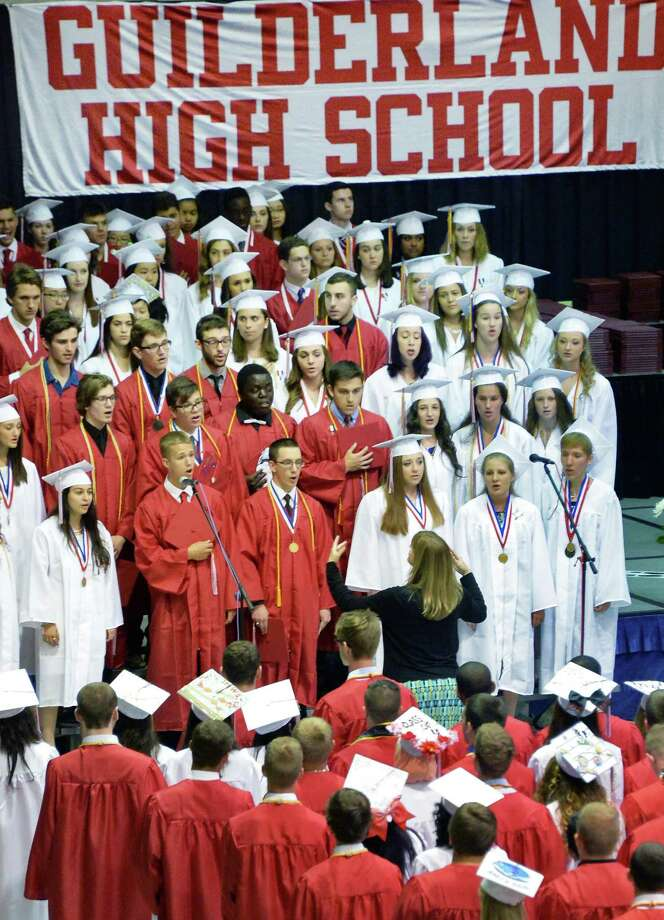 Concert Choir Seniors perform the National Anthem during graduation ceremonies for Guilderland High School at SEFCU Arena Saturday June 27, 2015 in Albany, NY.  (John Carl D'Annibale / Times Union) Photo: John Carl D'Annibale / 00032181A