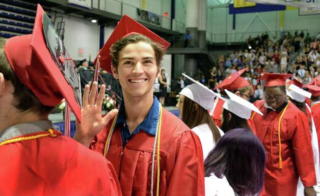 Corman Killeen waves to his family during graduation ceremonies for Guilderland High School at SEFCU Arena Saturday June 27, 2015 in Albany, NY.  (John Carl D'Annibale / Times Union) Photo: John Carl D'Annibale / 00032181A