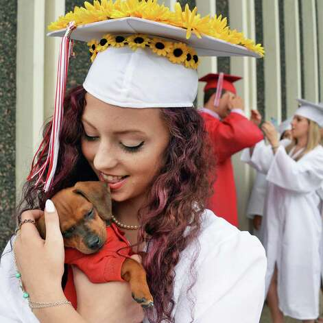 Rebekah Wolanski holds her puppy Tyrion before graduation ceremonies for Guilderland High School at SEFCU Arena Saturday June 27, 2015 in Albany, NY.  (John Carl D'Annibale / Times Union) Photo: John Carl D'Annibale / 00032181A