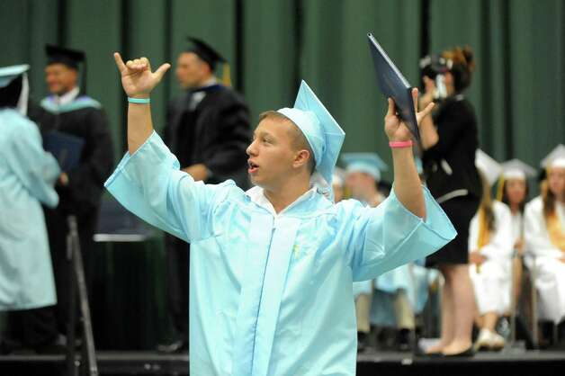 Graduate Eric Harris, center, celebrates the moment during the Columbia High commencement ceremony on Saturday, June 27, 2015, at Hudson Valley Community College in Troy, N.Y. (Cindy Schultz / Times Union) Photo: Cindy Schultz / 00032182A