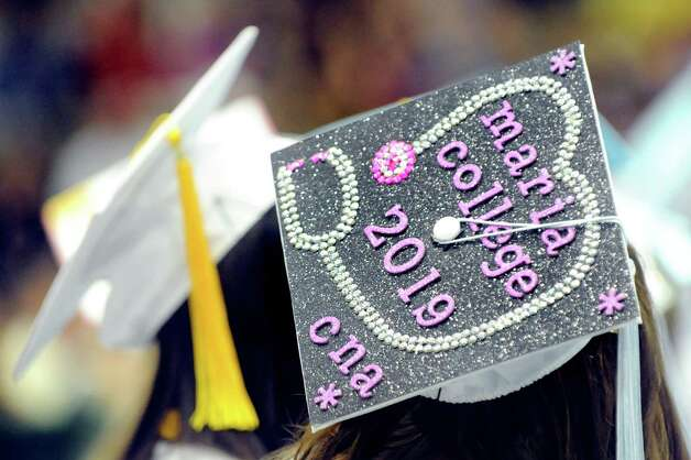 A graduate wears her education path during the Columbia High commencement ceremony on Saturday, June 27, 2015, at Hudson Valley Community College in Troy, N.Y. (Cindy Schultz / Times Union) Photo: Cindy Schultz / 00032182A