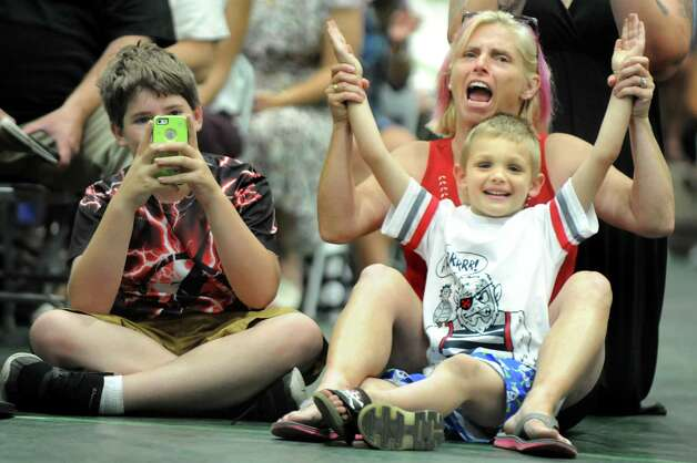 Micki Judd of Inkom, Idaho, center, cheers for a related graduate with her nephew Michael Oakes, 5, as her son Aaron Judd, 12, takes a picture during the Columbia High commencement ceremony on Saturday, June 27, 2015, at Hudson Valley Community College in Troy, N.Y. (Cindy Schultz / Times Union) Photo: Cindy Schultz / 00032182A