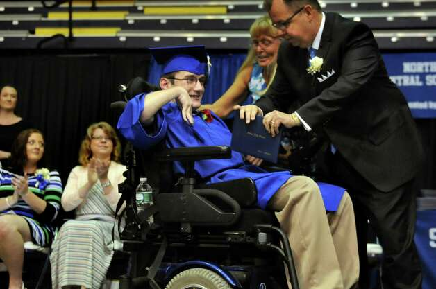 Graduate Riley Barker, center, receives his diploma from Principal Richard Murphy during the Shaker High commencement ceremony on Saturday, June 27, 2015, at UAlbany in Albany, N.Y. (Cindy Schultz / Times Union) Photo: Cindy Schultz / 00032180A