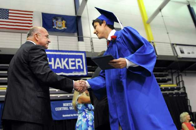 Graduate Christopher Bouchard, right, shakes hands with Superintendent D. Joseph Corr during the Shaker High commencement ceremony on Saturday, June 27, 2015, at UAlbany in Albany, N.Y. (Cindy Schultz / Times Union) Photo: Cindy Schultz / 00032180A