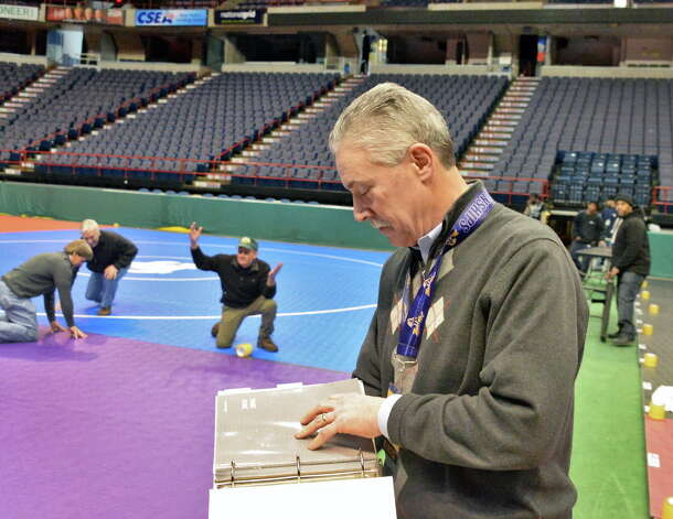 NYSPHSAA assistant director Bob Stulmaker oversees set up for the state wrestling championships at the Times Union Center Thursday Feb. 26, 2015, in Albany, NY. Event runs Friday and Saturday.  (John Carl D'Annibale / Times Union) Photo: John Carl D'Annibale / 00030774A