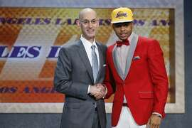 D'Angelo Russell, right, poses for a photo with NBA Commissioner Adam Silver after the Los Angeles Lakers selected Russell with the second pick during the NBA basketball draft, Thursday, June 25, 2015, in New York. (AP Photo/Kathy Willens)