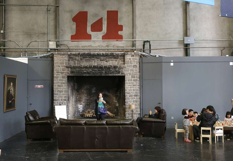 One of the seven original fireplaces used to heat the building during the PanamaÐPacific International Exposition in 1915 can be seen Inside the Palace of Fine Arts building where the current tenant The Innovation Hanger occupies the space in San Francisco, Calif., as seen on Sat. June 27, 2015. Photo: Michael Macor, The Chronicle