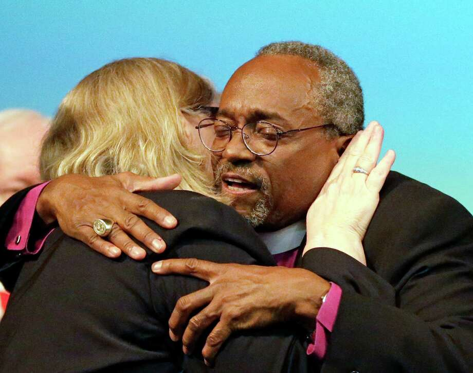 Bishop Michael Curry of North Carolina, receives a hug from Rev. Gay Clark Jennings after being elected the Episcopal Church's first African-American presiding bishop at the Episcopal General Convention Saturday, June 27, 2015, in Salt Lake City. Curry won the vote in a landslide. (AP Photo/Rick Bowmer) ORG XMIT: UTRB111 Photo: Rick Bowmer / AP