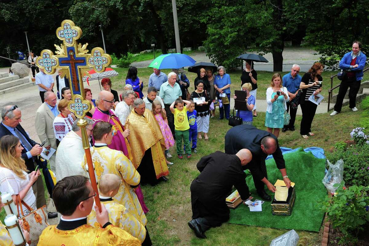 St. Peter & St. Paul Ukranian Greek Catholic Church celebrated its100th anniversary celebration with a church service, a procession outside to bless the building's cornerstone and bury a time capsule at the church in Ansonia, Conn., on Saturday June 27, 2015. Bishop Paul Chomnycky from the Ukranian Greek Catholic diocese in Stamford led a procession to bless the building's cornerstone and the time capsule.