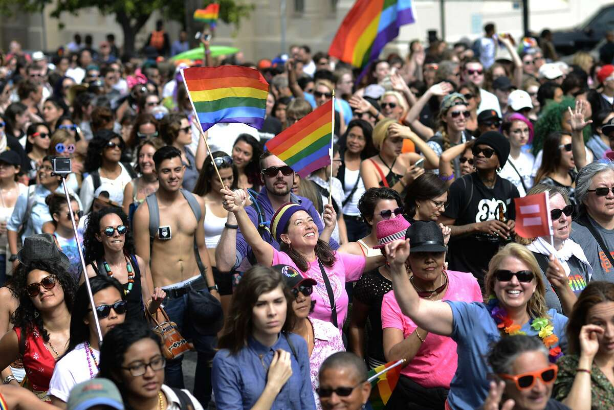 Supporters of gay pride and the Dyke March walk on 16th street in San Francisco, California, on Saturday, June 27, 2015.