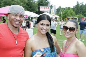 People pose for Seensters during The Woodlands Craft Beer and Music Festival  at Town Green Park, 2099 Lake Robbins Drive, Saturday, June 27, 2015.  Participating breweries included Abita, 8th Wonder Brewery, Omission, Saint Arnold, Karbach, Cycler's Brewing, Kona Brewing Co., Sierra Nevada, Rogue and Southern Star.