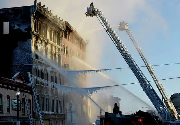 Fire has consumed three buildings on Jay Street Friday morning, March 6, 2015 in Schenectady, N.Y.  (Skip Dickstein/Times Union) Photo: SKIP DICKSTEIN