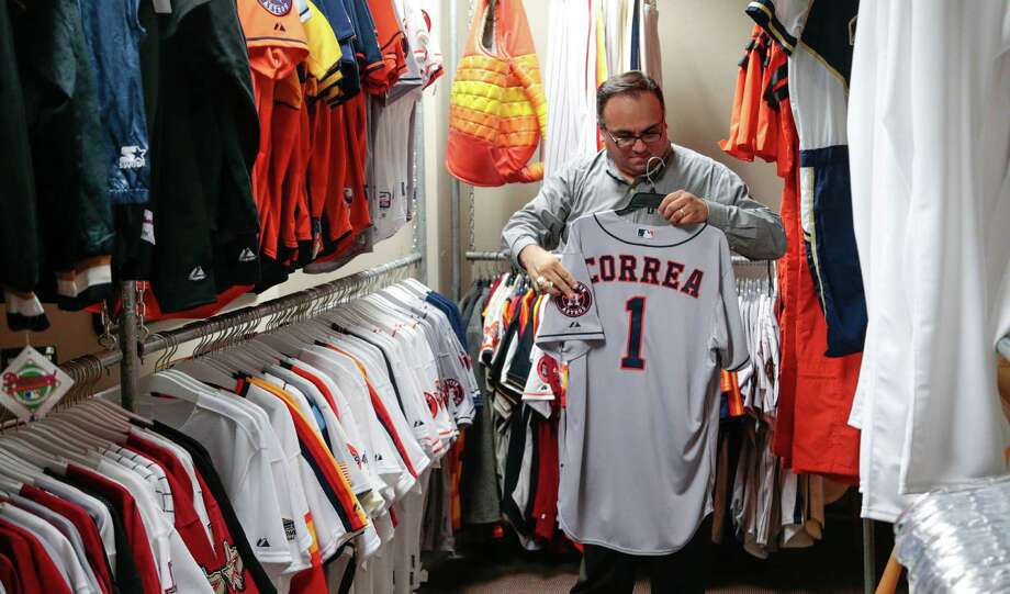 Houston Astros authentication manager Mike Acosta handles the first game-worn Carlos Correa jersey in the archival room at Minute Maid Park. Souvenir hunters love all things Correa. Photo: Billy Smith II, Staff / © 2015 Houston Chronicle