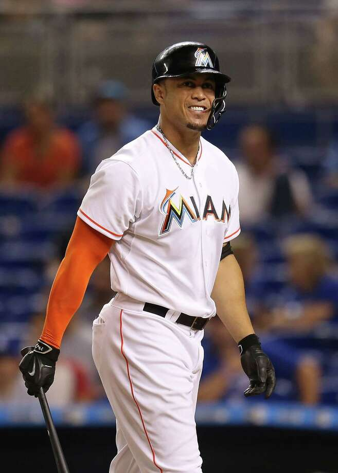 MIAMI, FL - JUNE 26: Giancarlo Stanton #27 of the Miami Marlins winces after striking out during the ninth inning of the game against the Los Angeles Dodgers at Marlins Park on June 26, 2015 in Miami, Florida. (Photo by Rob Foldy/Getty Images) ORG XMIT: 538584485 Photo: Rob Foldy / 2015 Getty Images