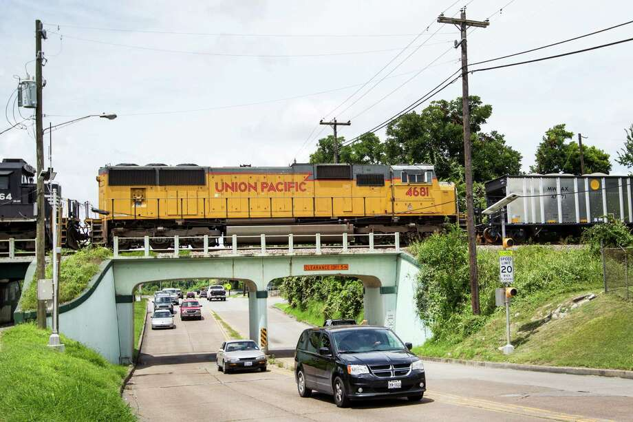 A train rolls through the East End over 75th Street on Saturday. Some residents are concerned about the safety of railcars carrying flammable crude oil, and they met with activists to discuss the issue. Photo: Brett Coomer, Staff / © 2015 Houston Chronicle