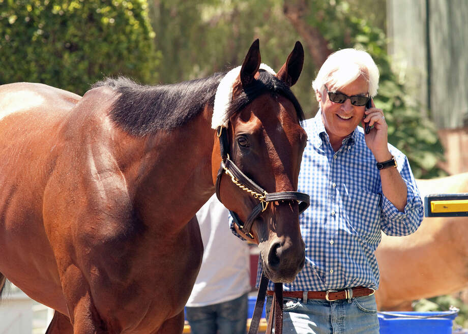 Triple Crown winner American Pharoah is walked by trainer Bob Baffert, right, as the horse arrives at Santa Anita Park in Arcadia, Calif., on Thursday, June 18, 2015. (Benoit Photo via AP) ORG XMIT: ARC102 / Benoit Photo