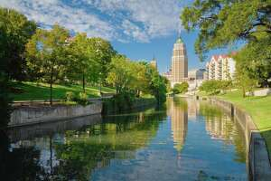 San Antonio Riverwalk in San Antonio Texas (TX).  The tower is the Tower Life Building, also called the Transit Tower or the Smith Young Tower.
