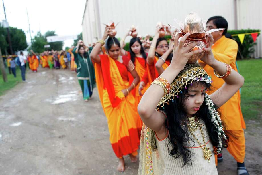 The first permanent Hindu temple in Katy celebrates a two-day opening with dancing, prayer, dinner and installation of the idol.