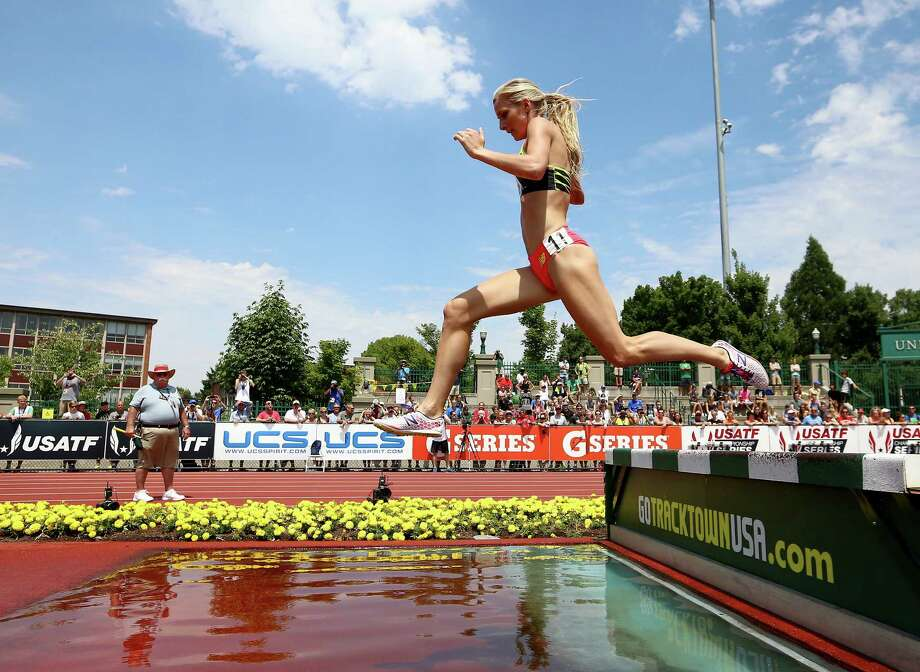 Emma Coburn clears the water pit on her way to winning the women's 3,000-meter steeplechase Saturday at Eugene, Ore. Photo: Ryan Kang, FRE / FR171219 AP