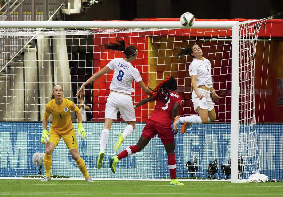 VANCOUVER, BC - JUNE 27: Claire Rafferty #3 of England heads the ball away from Kadeisha Buchanan #3 of Canada during the FIFA Women's World Cup Canada 2015 Quarter Final match between England and Canada June 27, 2015 at BC Place Stadium in Vancouver, British Columbia, Canada.  (Photo by Ben Nelms/Getty Images) ORG XMIT: 528453201 Photo: Ben Nelms / 2015 Getty Images