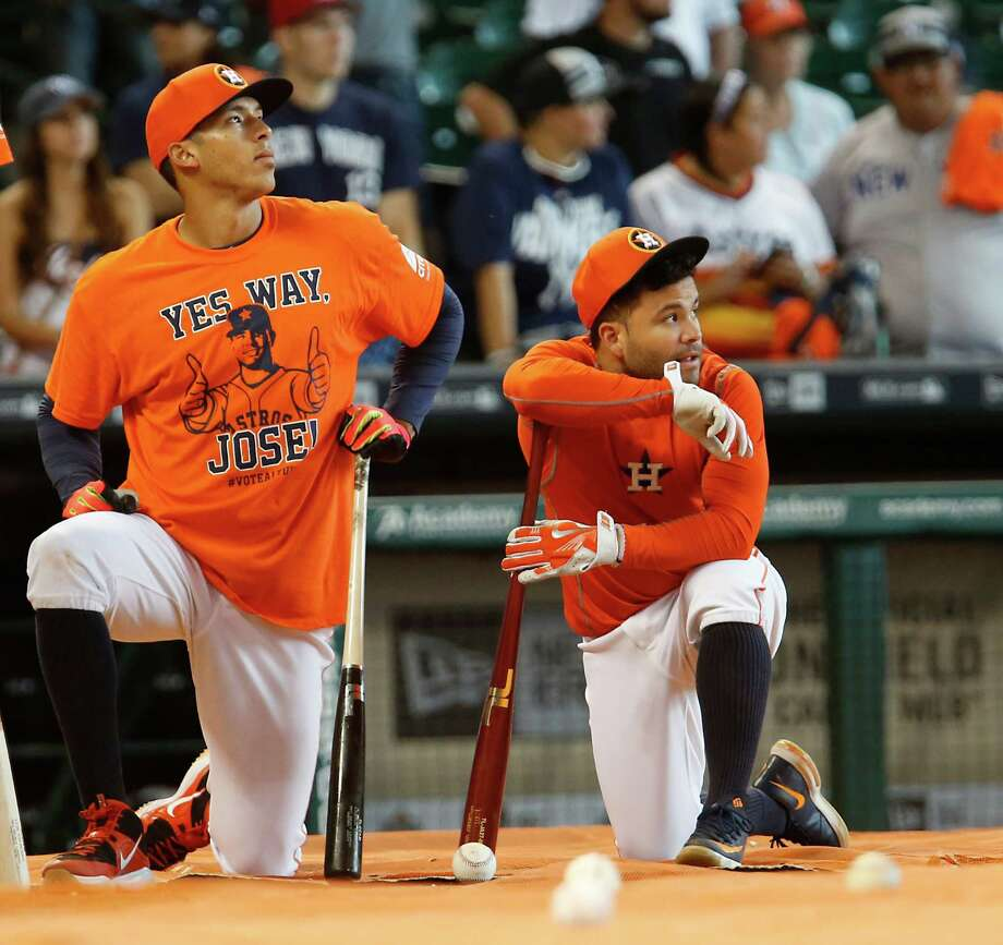 "Jose Altuve, right, might have been too modest for the fashion statement, but that didn't stop Carlos Correa and his teammates from sporting ""Yes way, Jose"" T-shirts to support the second baseman's All-Star candidacy. Photo: James Nielsen, Staff / © 2015  Houston Chronicle"