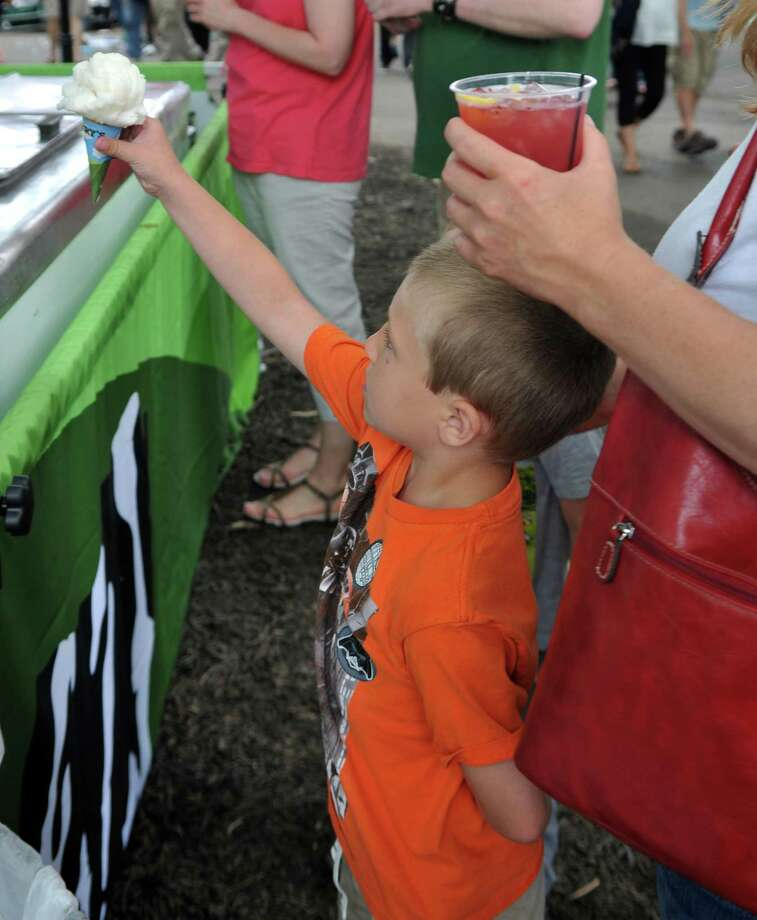 Elliot Epstein orders an ice cream cone from the Ben and Jerry's tent during Jazz Fest Saturday, June 27, 2015, at the Saratoga Performing Arts Center in Saratoga Springs, N.Y. (Phoebe Sheehan/Special to The Times Union) Photo: PS / 00032400A