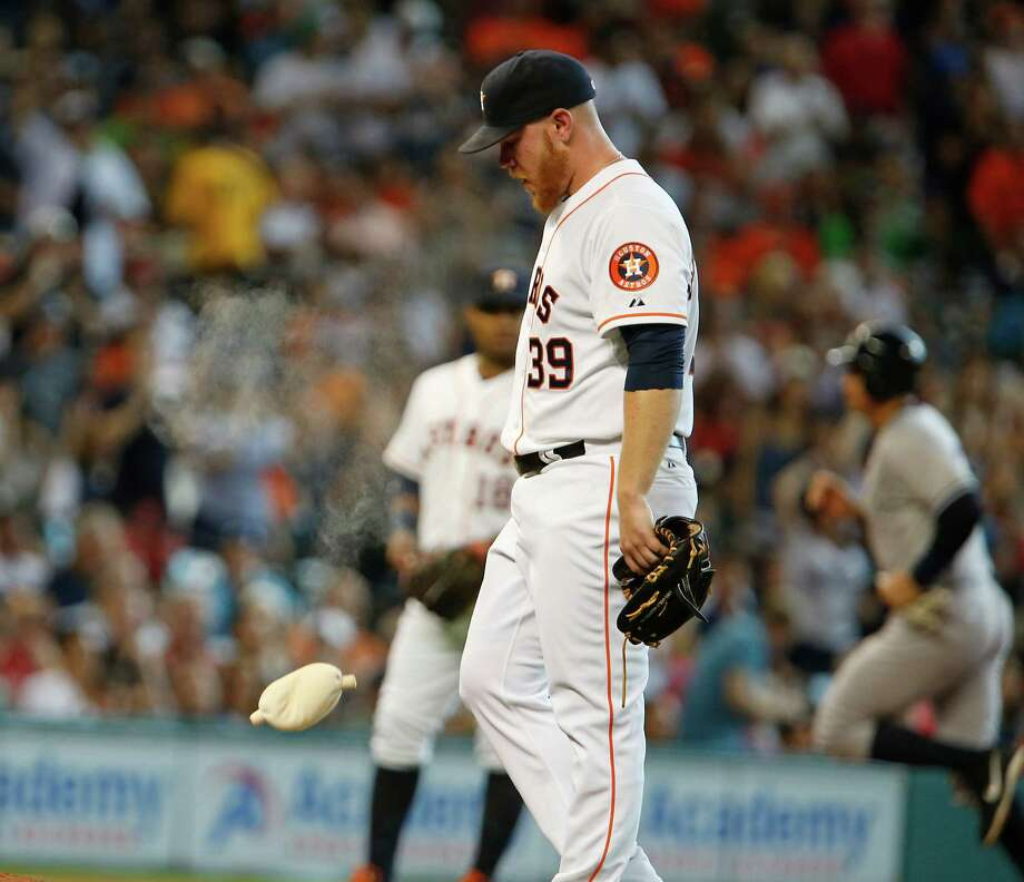 The day didn't start or end well for the Astros' Brett Oberholtzer. After giving up a grand slam in the first inning, he was ejected in the second after throwing a pitch that nearly hit Alex Rodriguez. Photo: James Nielsen, Staff / © 2015  Houston Chronicle