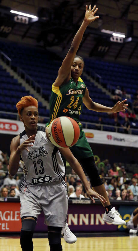 San Antonio Stars' Danielle Robinson passes under Seattle Storm's Jewell Loyd during first half action Saturday June 27, 2015 at the Freeman Coliseum. Photo: Edward A. Ornelas, Staff / San Antonio Express-News / © 2015 San Antonio Express-News