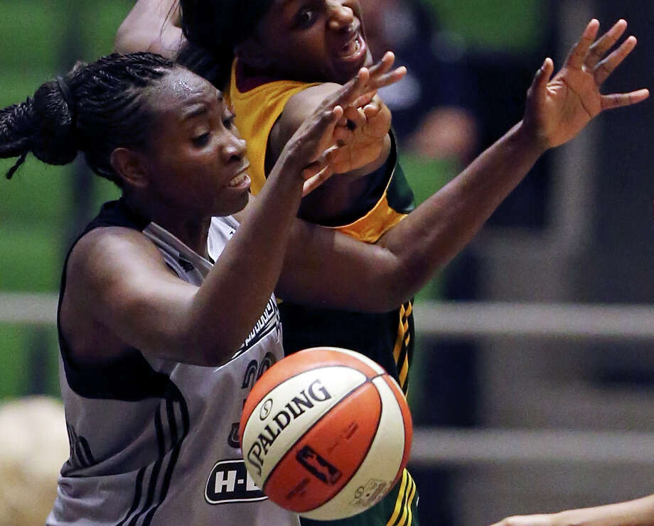 San Antonio Stars' Sophia Young-Malcolm and Seattle Storm's Crystal Langhorne grab for a rebound during second half action on June 27, 2015 at the Freeman Coliseum. The Stars won 73-71. Photo: Edward A. Ornelas /San Antonio Express-News / © 2015 San Antonio Express-News