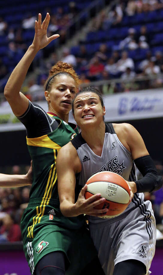 San Antonio Stars' Kayla McBride drives around Seattle Storm's Alysha Clark during second half action Saturday June 27, 2015 at the Freeman Coliseum. The Stars won 73-71. Photo: Edward A. Ornelas, Staff / San Antonio Express-News / © 2015 San Antonio Express-News