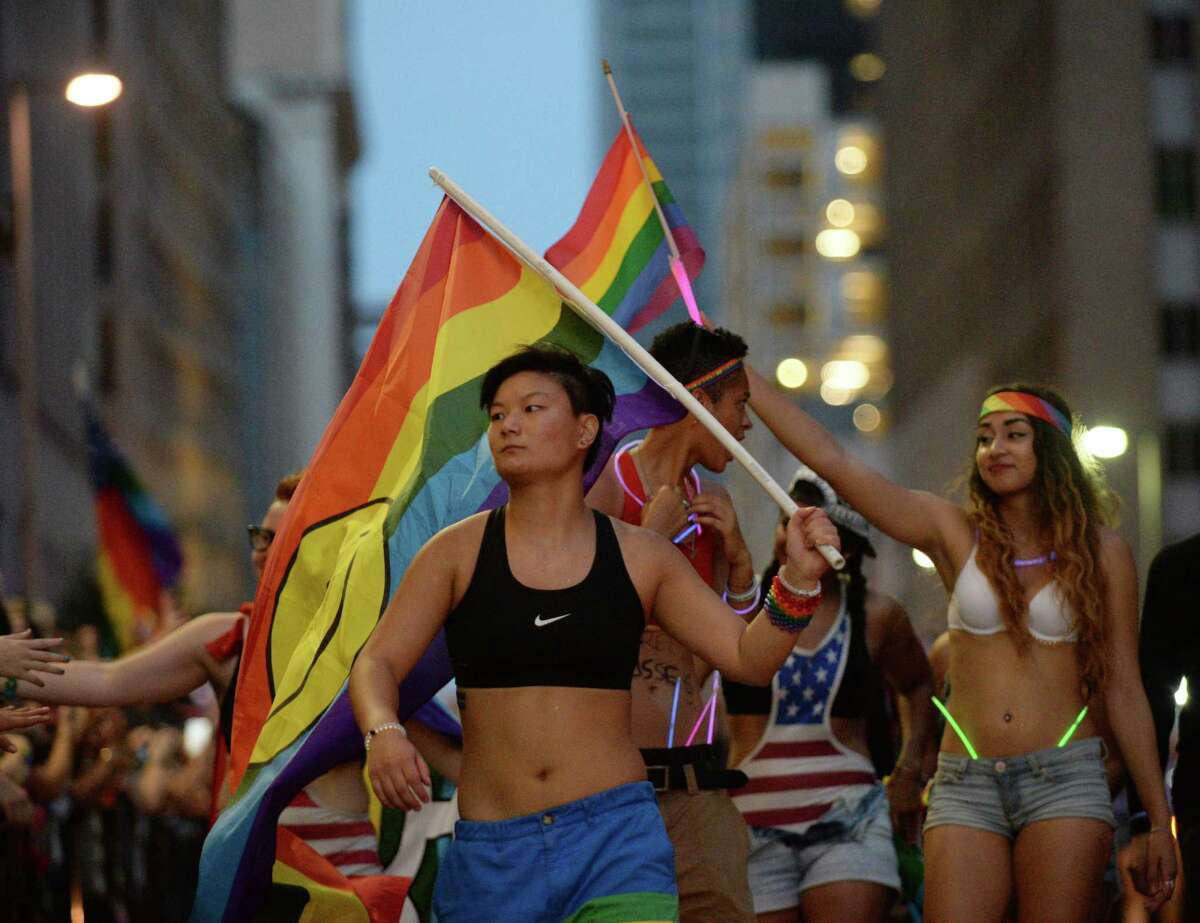 Vivian Young, center, marches in the 2015 Houston Pride parade Saturday, June 27, 2015, in Houston.