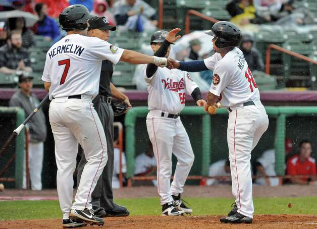 Tri-City ValleyCats # 10 Edwin Medina, right, is congratulated by team mates after being driven in by Trent Woodward during Saturday night's against the Staten Island Yankees at Joe Bruno Stadium June 27, 2015 in Troy, NY.  (John Carl D'Annibale / Times Union) Photo: John Carl D'Annibale / 00032383A