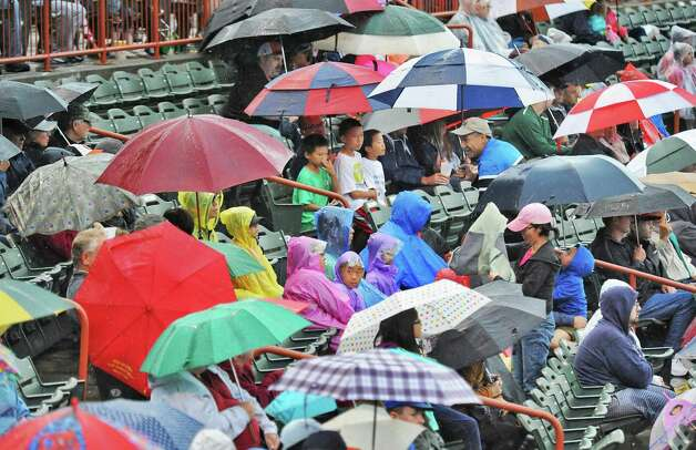 Tri-City ValleyCats fans brave a steady rain during Saturday night's game against the Staten Island Yankees at Joe Bruno Stadium  June 27, 2015 in Troy, NY.  (John Carl D'Annibale / Times Union) Photo: John Carl D'Annibale / 00032383A