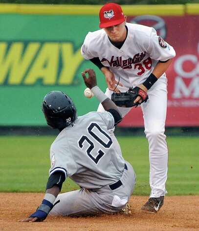 Staten Island Yankees #20 Junior Valera, left, beats the throw to Tri-City ValleyCats' #38 Kolbey Carpenter during Saturday night's game at Joe Bruno Stadium June 27, 2015 in Troy, NY.  (John Carl D'Annibale / Times Union) Photo: John Carl D'Annibale / 00032383A
