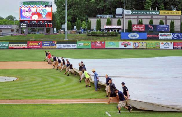 Tri-City ValleyCats ground crew covers the infield before Saturday night's game against the Staten Island Yankees at Joe Bruno Stadium  June 27, 2015 in Troy, NY.  (John Carl D'Annibale / Times Union) Photo: John Carl D'Annibale / 00032383A