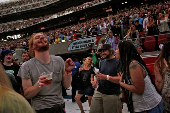"Grateful Dead fans dance during the first show of the band's ""Fare Thee Well"" tour, which concludes Sunday in Chicago."