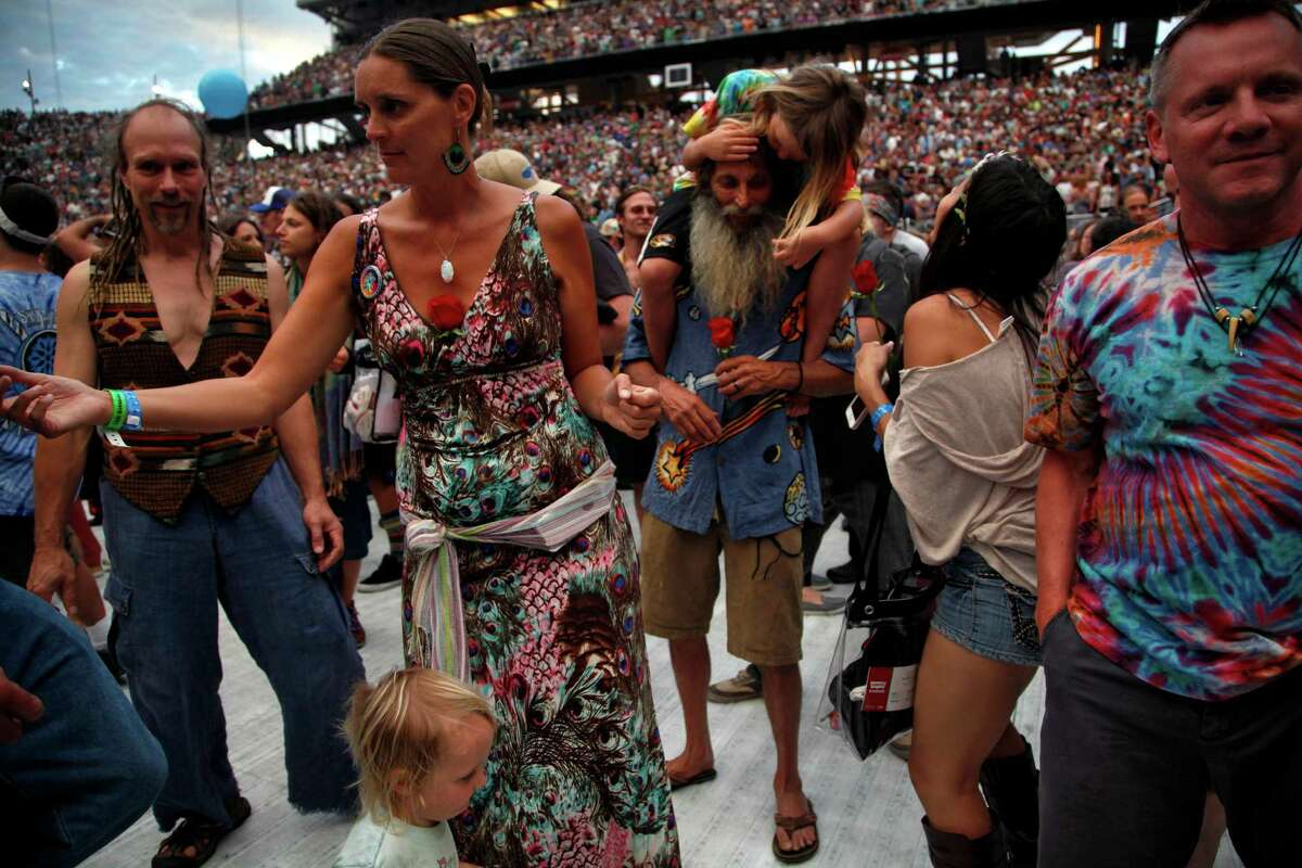 Fans dance during the first set of the first of five Fare Thee Well shows by the Grateful Dead at Levi's Stadium in Santa Clara, Calif., on Saturday, June 27, 2015.
