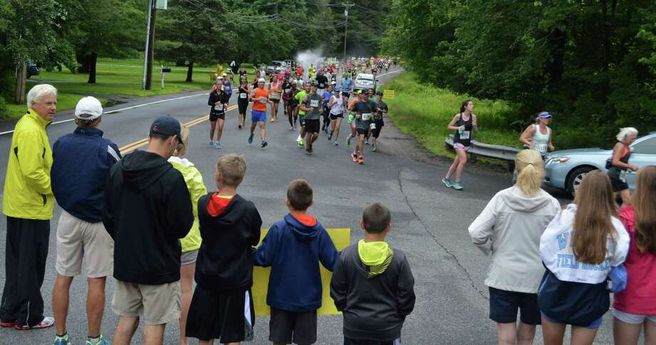 Crowds gathered at New Creek and Greens Farms roads to cheer on the racers Sunday morning in the Fairfield Half Marathon as they ran the Greens Farms section of the course. Photo: Jarret Liotta / For Hearst Connecticut Media / Westport News