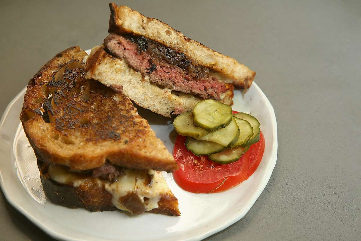 Owner/chef Chris Kronner makes a patty melt at home in Oakland, Calif., on Wednesday, June 24, 2015.