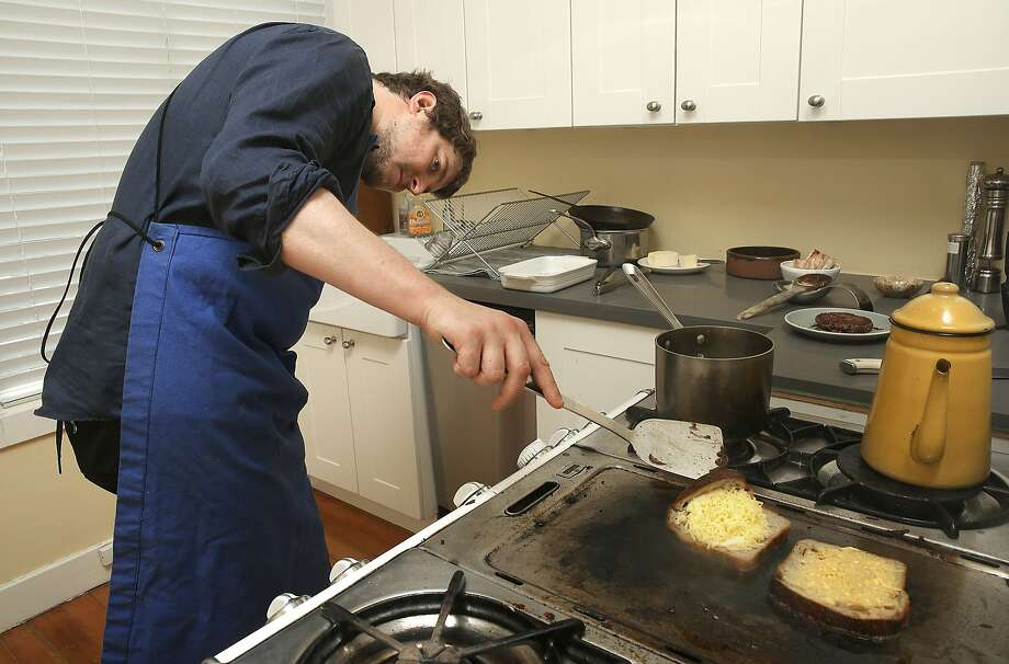 Owner/chef Chris Kronner browns pieces of  bread while showing how to make a patty melt at home in Oakland, Calif.,  on Wednesday, June 24, 2015. Photo: Liz Hafalia, The Chronicle