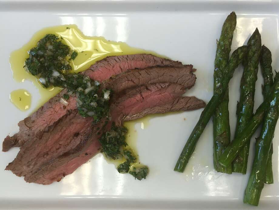 Flank steak with chimichurri and asparagus Photo: Amanda Gold
