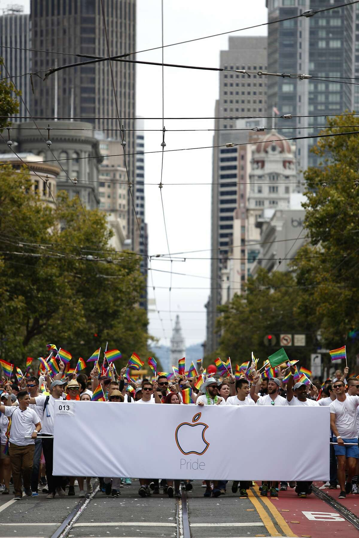Apple shows their support as they walk down Mark Street during the Pride Parade in San Francisco, California, on Sunday, June 28, 2015.