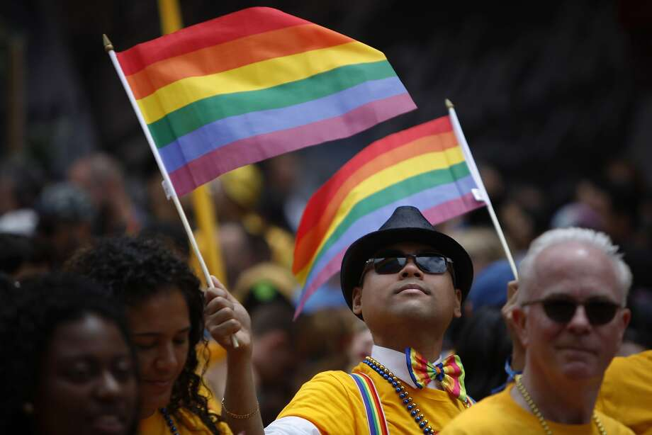 Street performers and Pride supporters walk down Market Street during the Pride Parade in San Francisco, California, on Sunday, June 28, 2015. Photo: Brandon Chew, The Chronicle