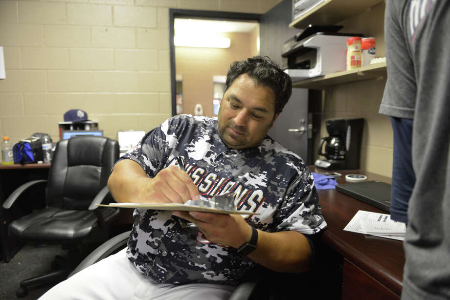 New Missions Manager Rod Barajas does paperwork at his desk inside Wolff Stadium. Barajas was waiting out a rain delay Wednesday night. Photo: Robin Jerstad, Freelance / San Antonio Express-News