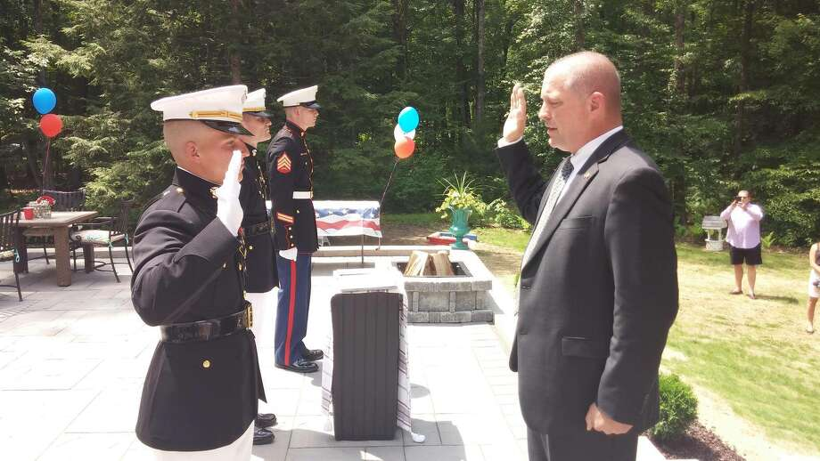 Marine Corps Newly commissioned Marine 2nd Lt. Nicholas H. Feldmaier receives his officers oat from his uncle, retired Marine Lt. Col. Stephen G. LaBlanc during ceremony in Clifton Park.